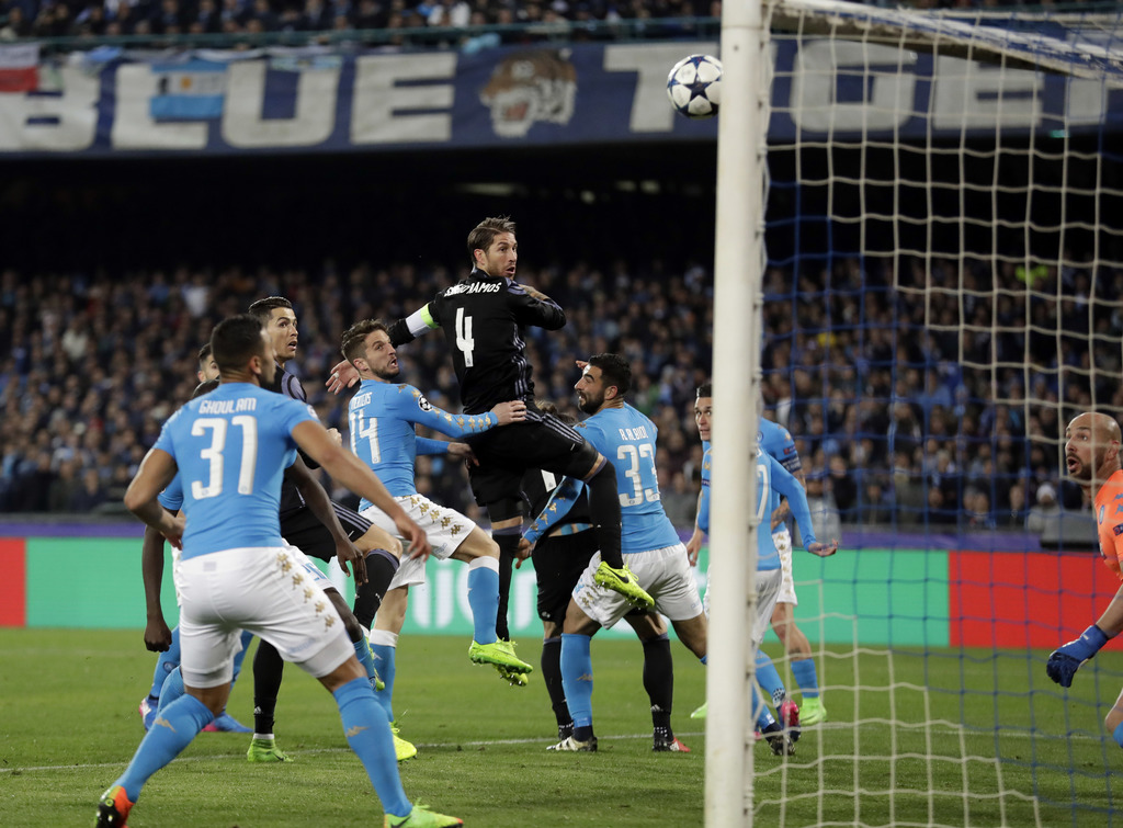Real Madrid's Sergio Ramos, center, scores his side's first goal during the Champions League round of 16, second leg, soccer match betw...