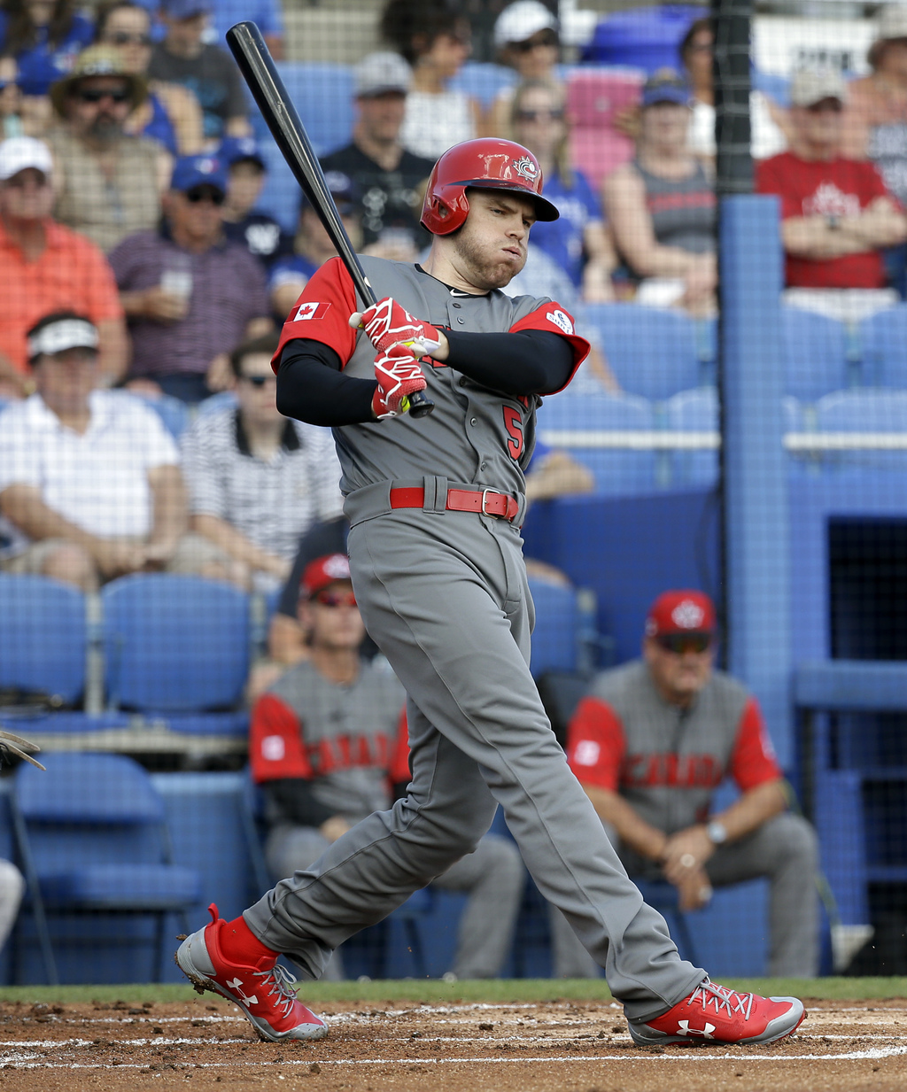 Canada's Freddie Freeman drives in a run on a base hit in the first inning during an exhibition baseball game against the Toronto Blue ...