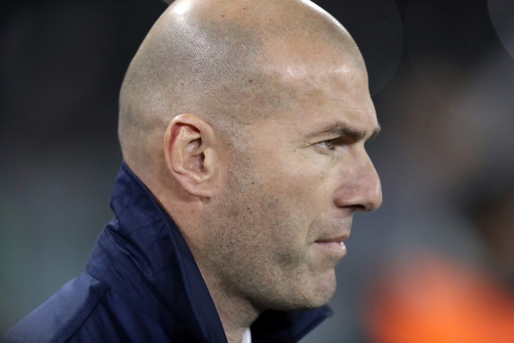 Real Madrid's head coach Zinedine Zidane stands by the bench before the Champions League round of 16, second leg, soccer match between ...