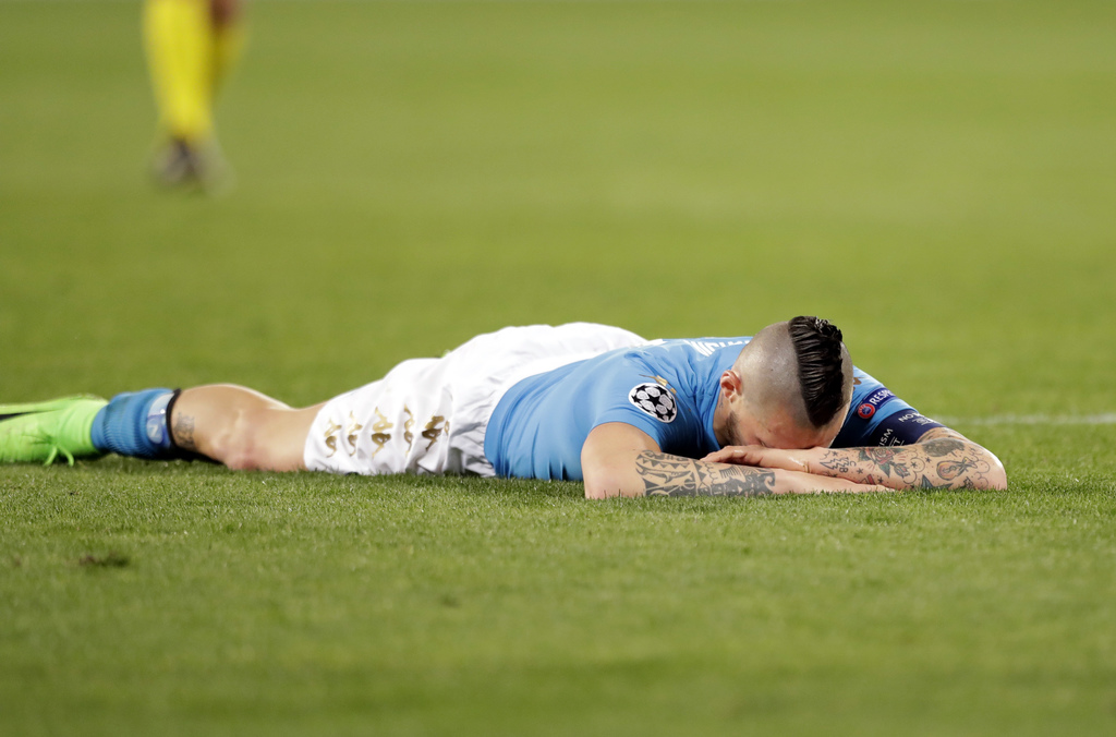 Napoli's Marek Hamsik lies on the pitch during the Champions League round of 16, second leg, soccer match between Napoli and Real Madri...