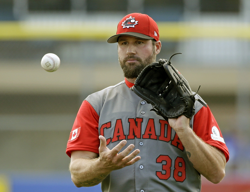 Canada pitcher Eric Gagne catches the ball after a warm up pitch before pitching against the Toronto Blue Jays in the fourth inning of ...