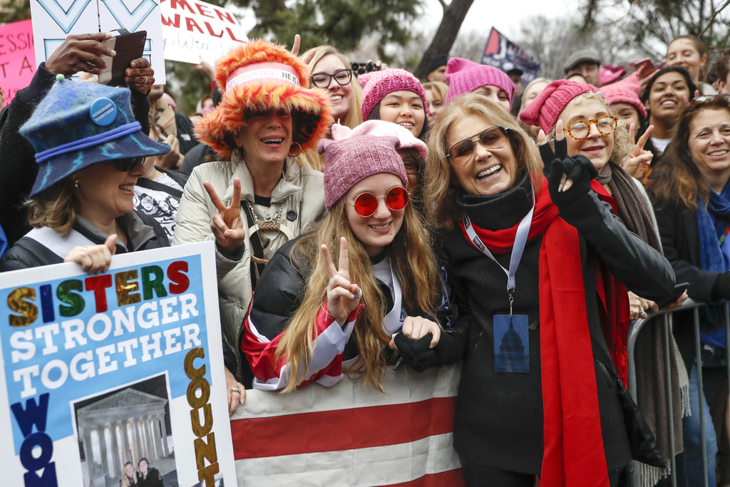 FILE - In this Jan. 21, 2017 file photo, Gloria Steinem, center right, greets protesters at the barricades before speaking at the Women...