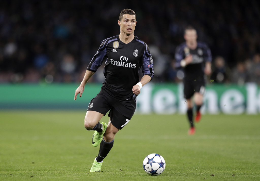 Real Madrid's Cristiano Ronaldo runs with the ball during the Champions League round of 16, second leg, soccer match between Napoli and...