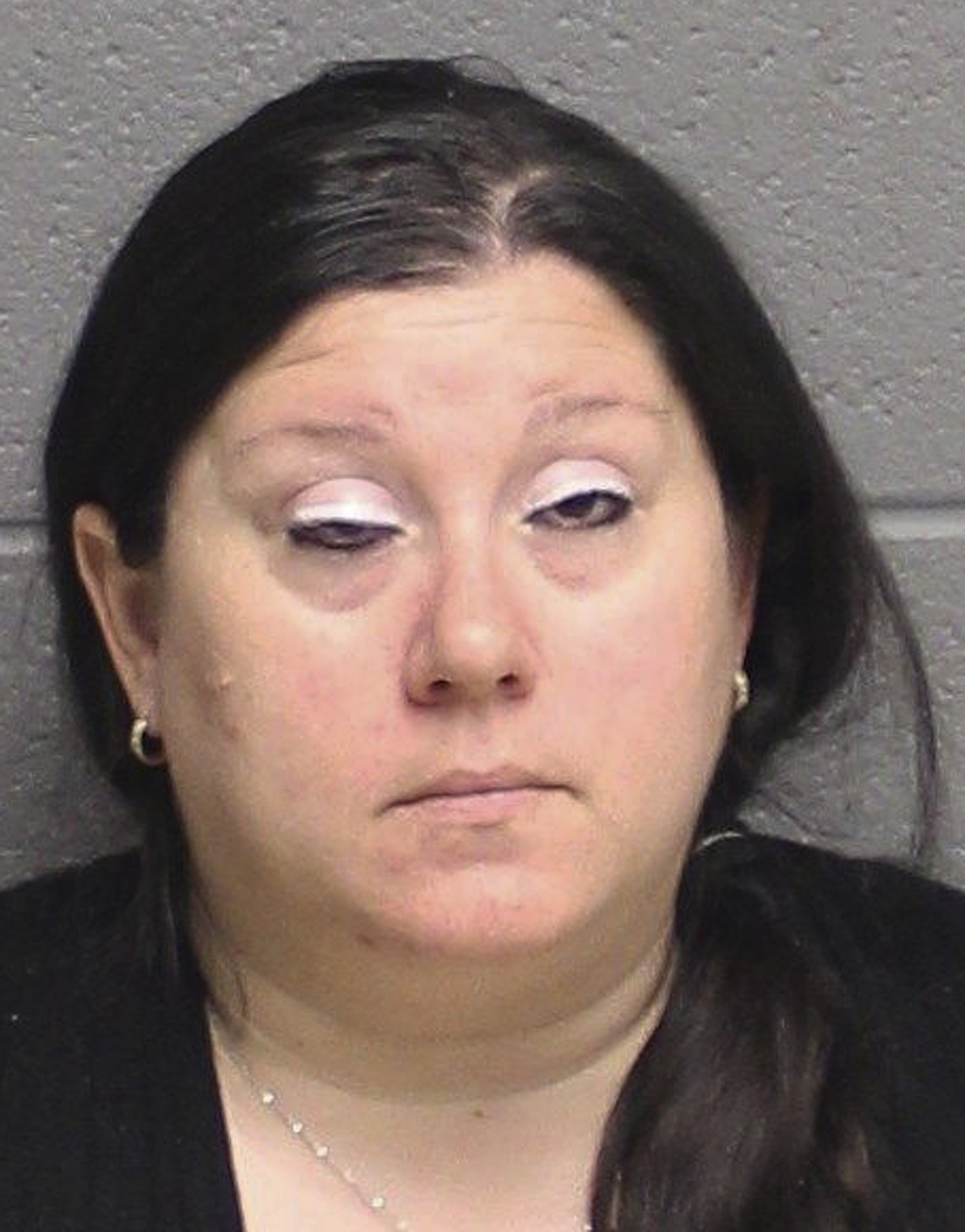 This undated booking photograph provided by the Monroe, Conn., Police Department shows Lisa Nussbaum, arrested and charged Friday, Marc...