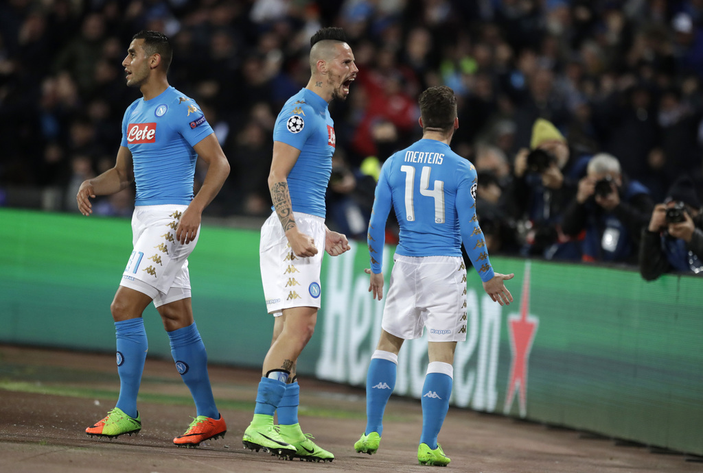 Napoli's Marek Hamsik, center, celebrates after Dries Mertens, right,scored the opening goal during the Champions League round of 16, s...