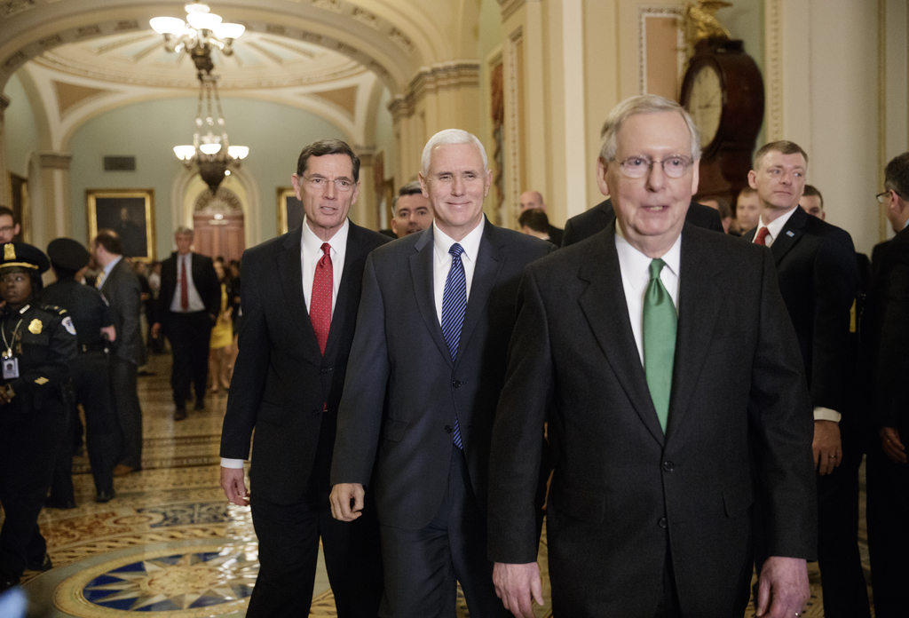 Vice President Mike Pence, center, smiles as he joins Senate Majority Leader Mitch McConnell, R-Ky., right, and Sen. John Barrasso, R-W...