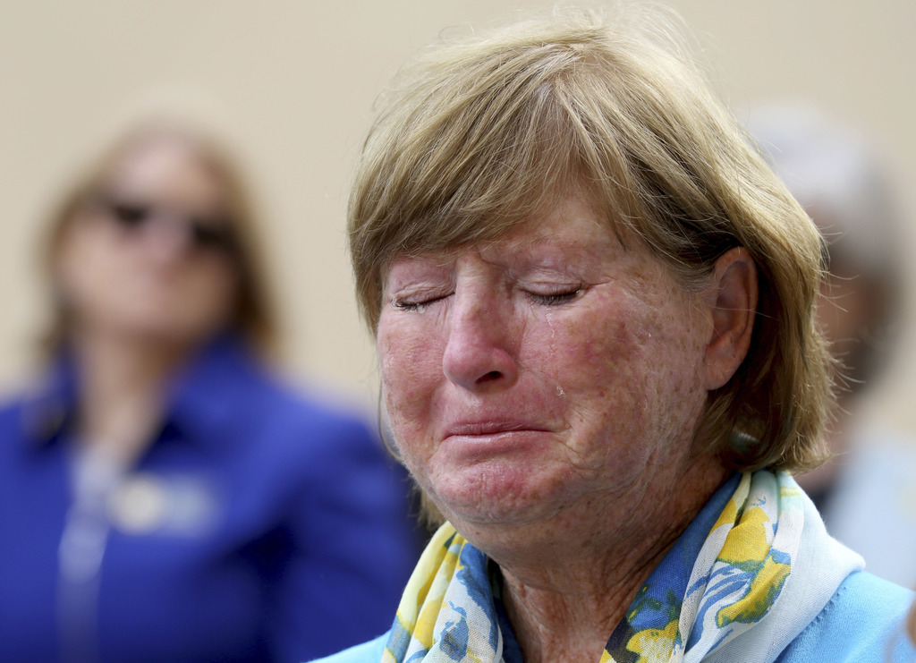 FILE -- In this March 5, 2016 file photo, Robert Levinson's sister, Judi Levinson cries during a rally for Robert Levinson, a former FB...