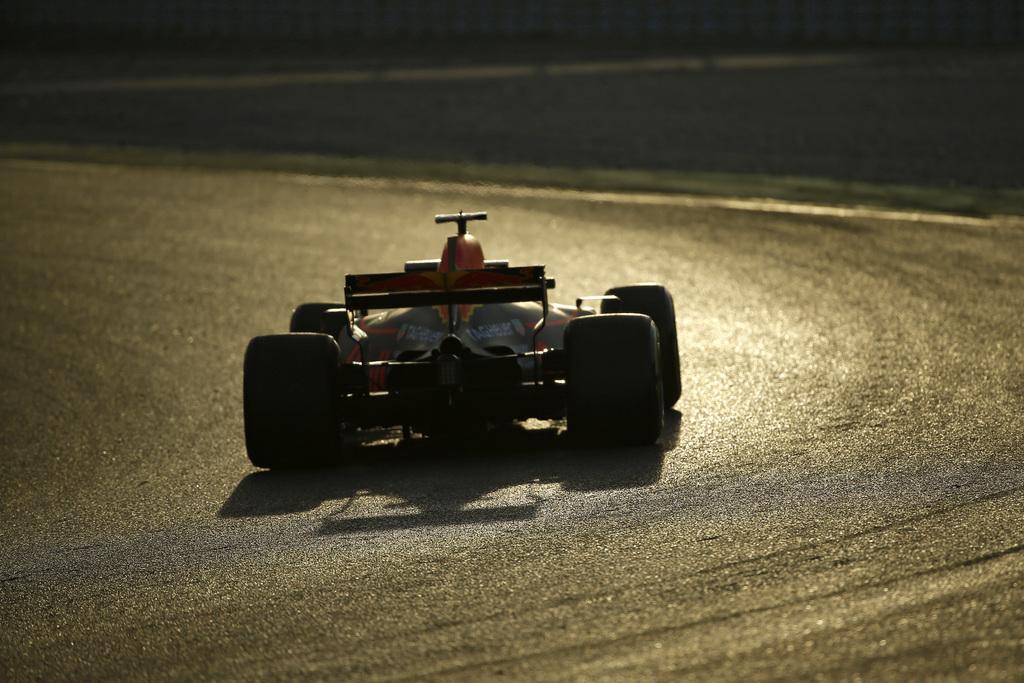 Red Bull driver Daniel Ricciardo of Australia steers his car during a Formula One pre-season testing session at the Catalunya racetrack...