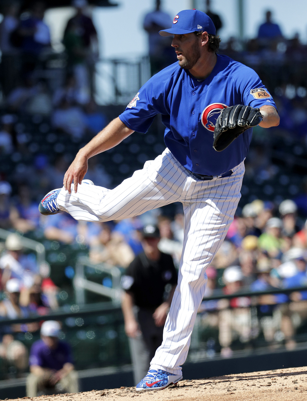 Chicago Cubs pitcher John Lackey throws against Italy during the second inning of an exhibition baseball game, Tuesday, March 7, 2017, ...
