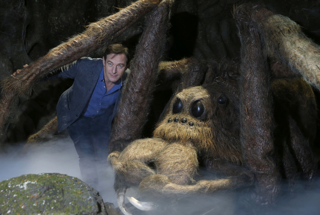 Actor Jason Isaacs poses for the media next to Aragog the Acromantula at a new extension called the 'Forbidden Forest' to the Warner Br...