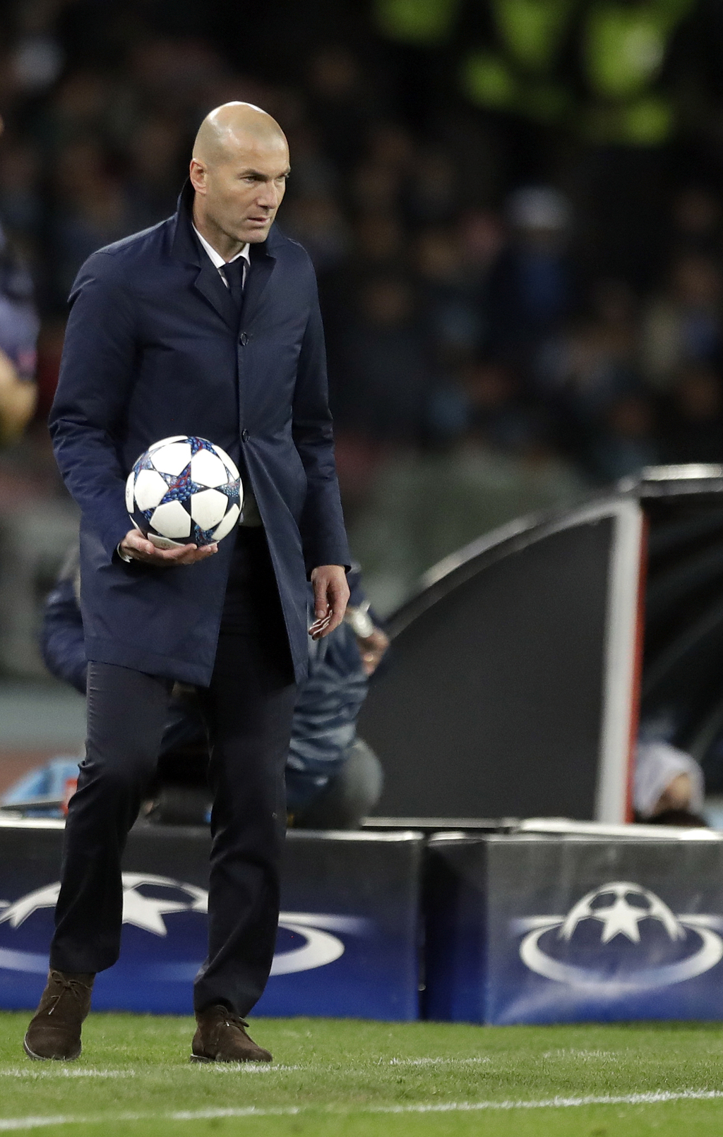 Real Madrid's head coach Zinedine Zidane holds a ball during the Champions League round of 16, second leg, soccer match between Napoli ...