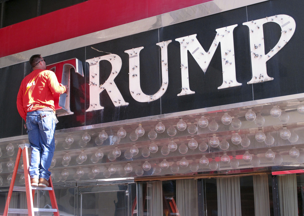 FILE - In this file photo taken Oct. 6, 2014, a worker removes letters from a Trump logo in Atlantic City, N.J.China has granted prelim...