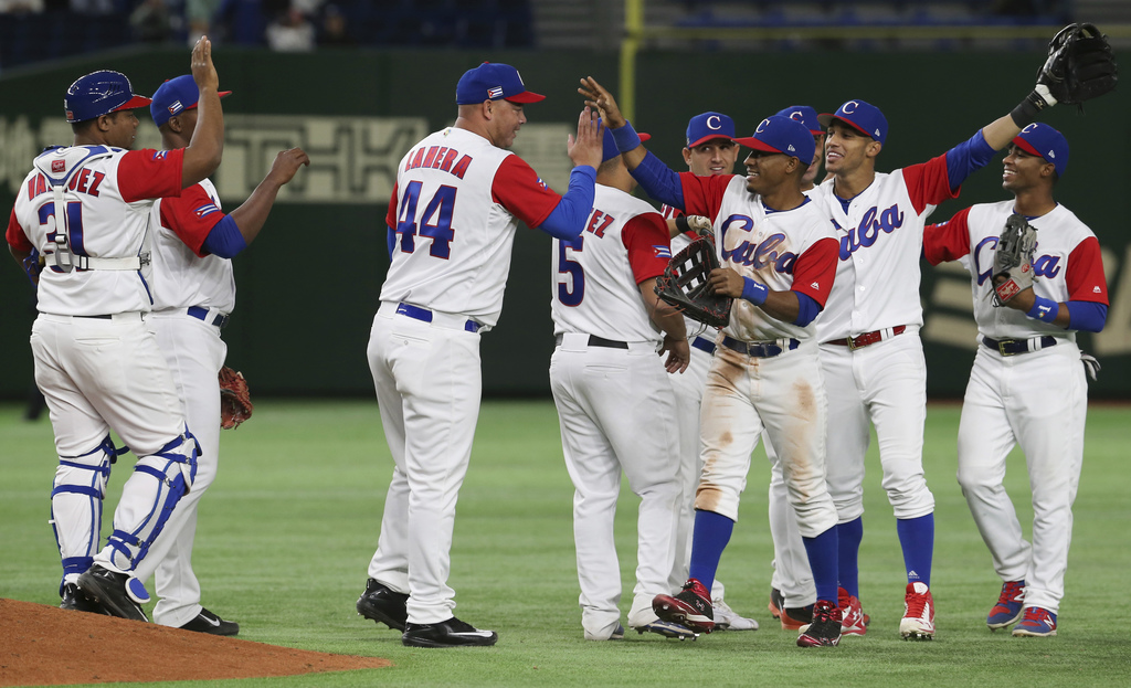 Cuba's players celebrate after their 6-0 win over China in their first round game of the World Baseball Classic at Tokyo Dome in Tokyo,...