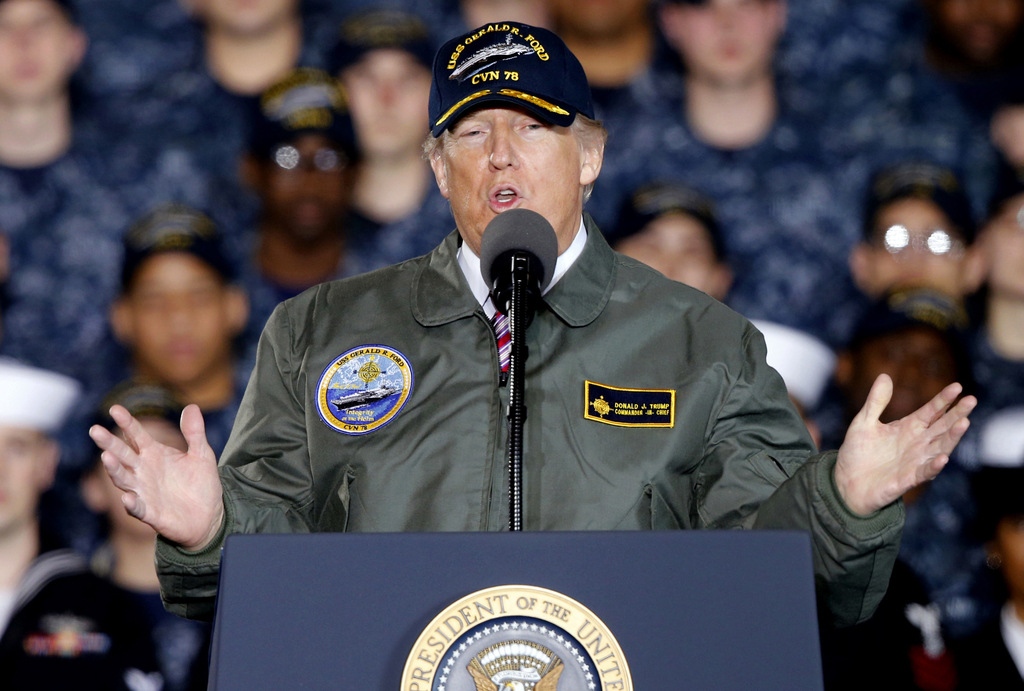 FILE - In this March 2, 2017, photo, President Donald Trump gestures as he speaks to Navy and shipyard personnel aboard nuclear aircraf...