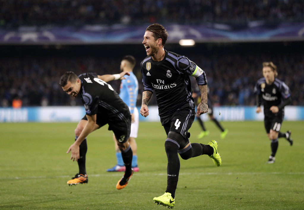 Real Madrid's Sergio Ramos celebrates after scoring his side's second goal during the Champions League round of 16, second leg, soccer ...