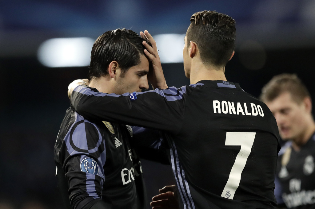 Real Madrid's Alvaro Morata, left, celebrates with Cristiano Ronaldo after scoring his side's third goal during the Champions League ro...