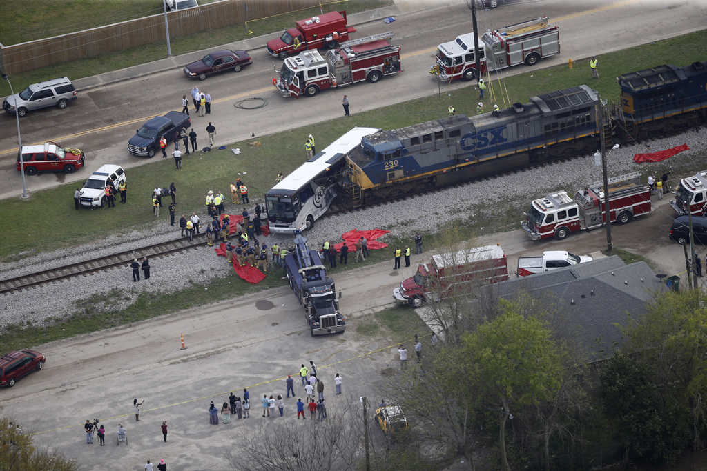 Responders works the scene where a train hit a bus in Biloxi, Miss., Tuesday, March 7, 2017. A freight train smashed into a charter bus...
