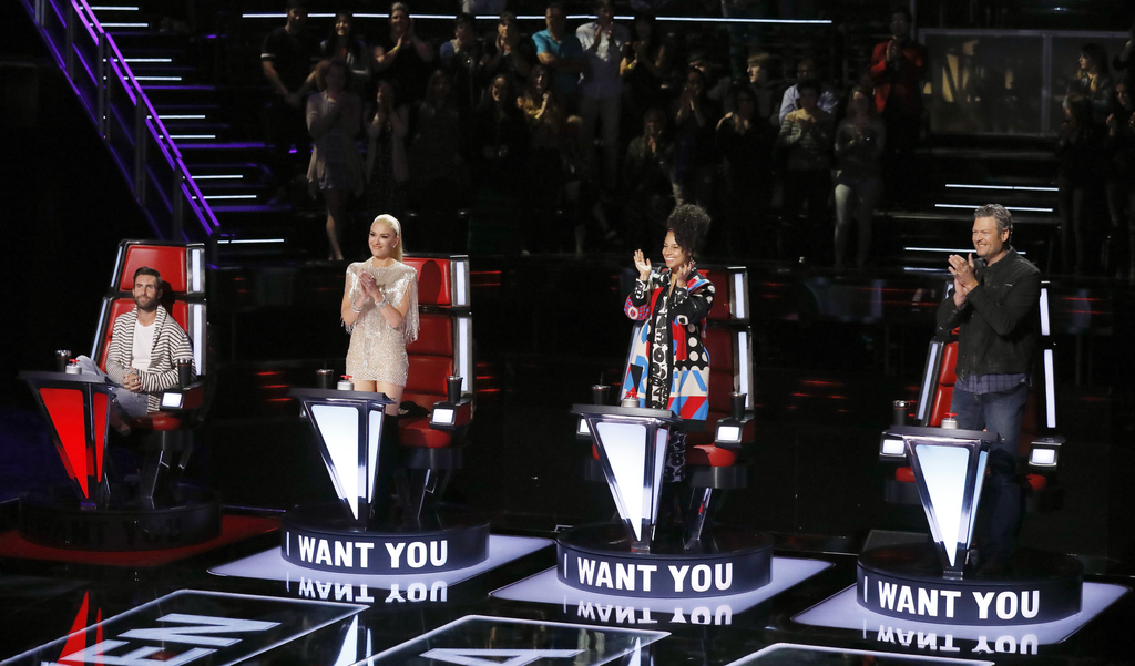 """This image released by NBC shows judges, from left, Adam Levine, Gwen Stefani, Alicia Keys and Blake Shelton on the set of """"The Voice,""""..."""