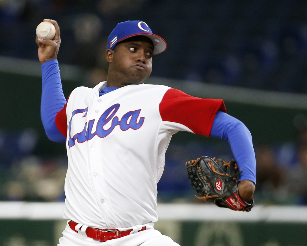 Cuba's starter Vladimir Banos pitches against China during the first inning of their first round game of the World Baseball Classic at ...