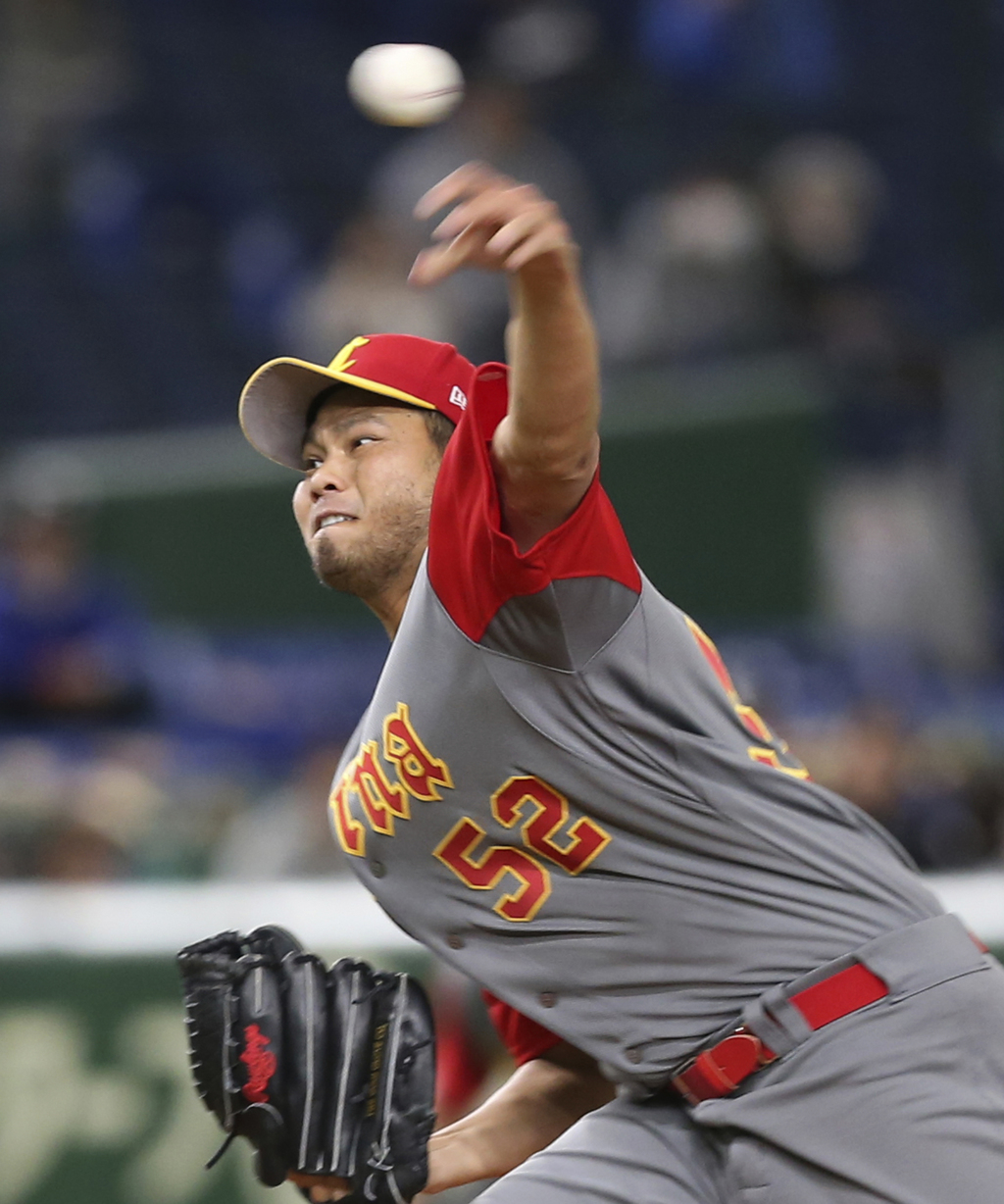 China's starter Bruce Chen pitches against Cuba during the second inning of their first round game at the World Baseball Classic at Tok...
