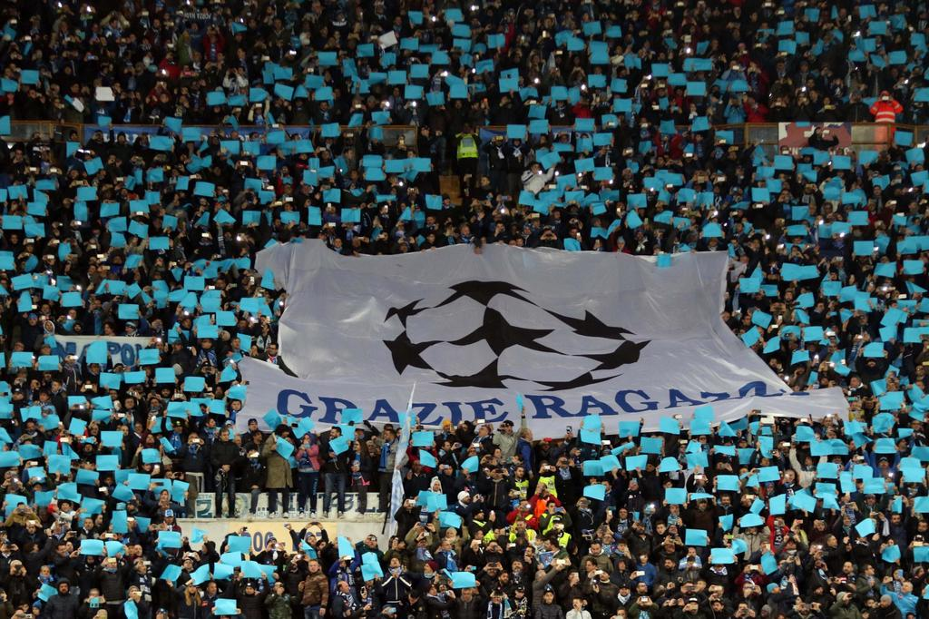 Napoli's fans show a banner reading: 'Thank you guys' prior to the start of a Champions League, round of 16, return-leg soccer match be...
