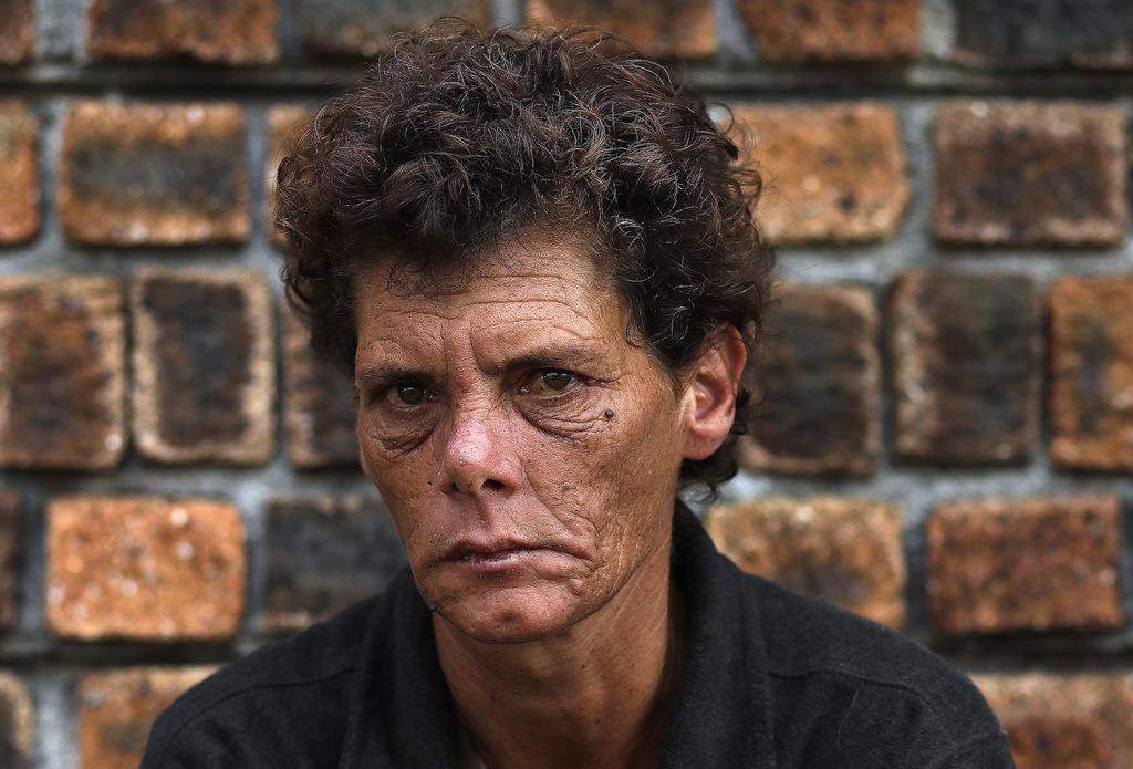 Raechel Van Der Burg, sits on a street corner in Germiston, east of Johannesburg, South Africa, Friday, March 3, 2017. Van Der Burg, a ...