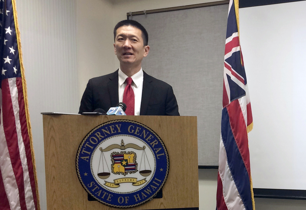 FILE - In this Feb. 3, 2017, file photo, Hawaii Attorney General Doug Chin speaks at a news conference in Honolulu announcing the state...