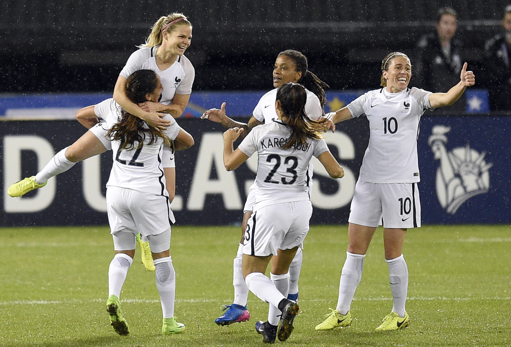 France forward Eugenie Le Sommer, top left, celebrates her goal with midfielder Amel Majri (22), Sakina Karchaoui (23) Camille Abily (1...