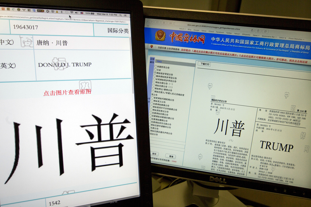 Computer screens showing some of the Trump trademarks approved by China's Trademark office and seen on their website in Beijing, China,...