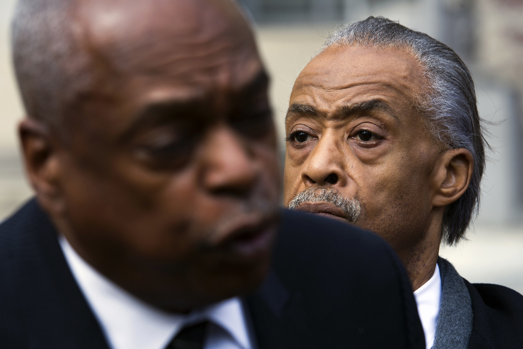 Rev. Al Sharpton listens at right as Wade Henderson, president of the Leadership Conference on Civil and Human Rights, speaks at a news...