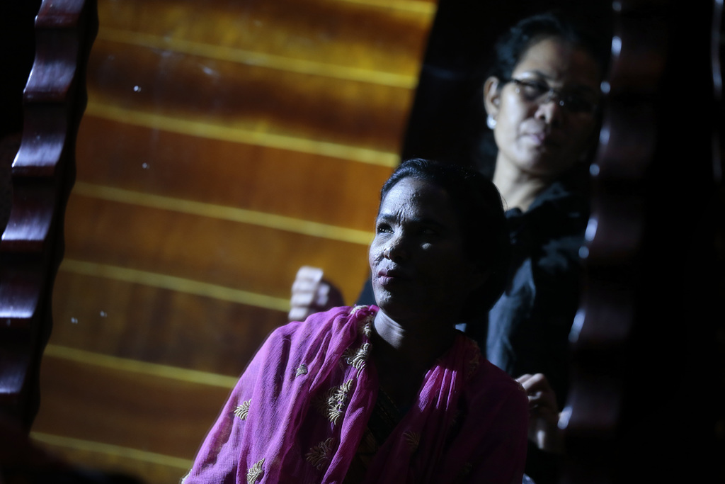 In this March 7, 2017 photo, a Bangladeshi acid attack survivor waits in backstage during the event 'Beauty Redefined' in Dhaka, Bangla...