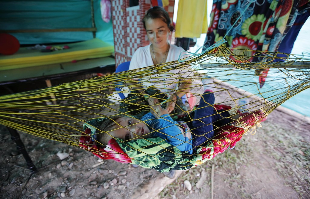 In this Tuesday, Feb. 28, 2017 photo, FARC rebel Nelcy Rios cares for her 9-month-old daughter Naiha Sofia inside her tent at a rebel c...