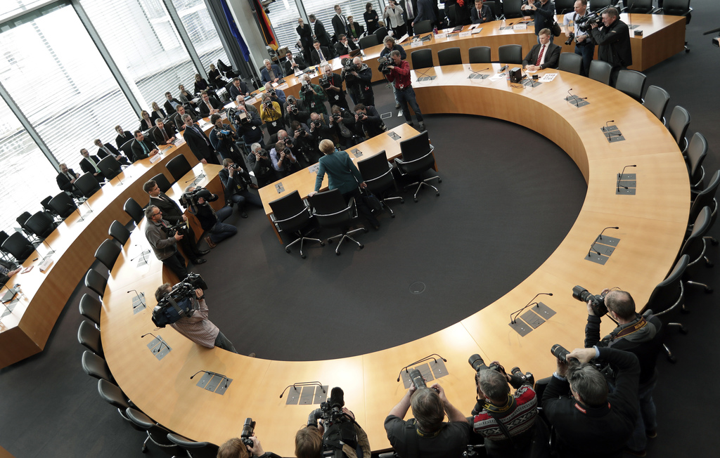 German Chancellor Angela Merkel, takes a seat as she arrives for a questioning by a parliamentary  committee investigating the Volkswag...