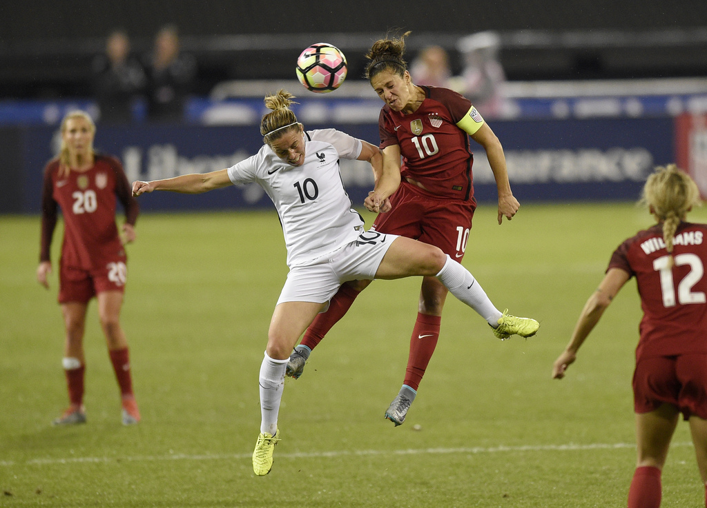 France midfielder Camille Abily, left, battles for the ball against United States midfielder Carli Lloyd, right, during the first half ...