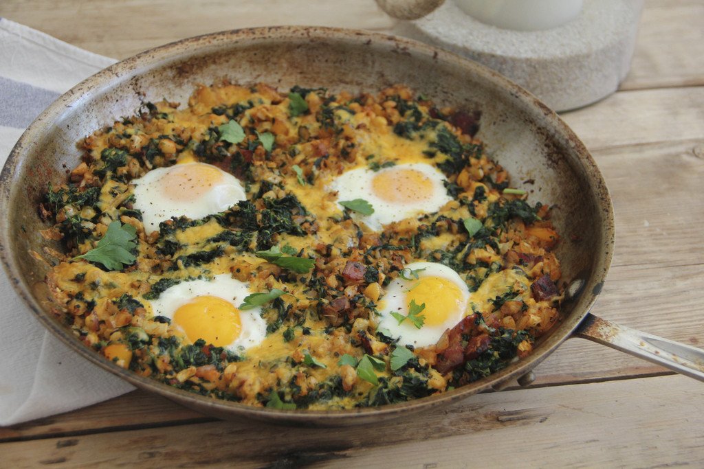 This March 6, 2017 photo shows a country-style breakfast skillet with eggs, bacon and vegetables in Coronado, Calif. This dish is from ...