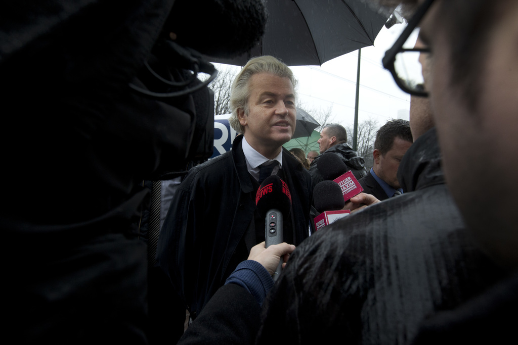 Firebrand anti Islam lawmaker Geert Wilders protests outside the Turkish embassy in The Hague, Netherlands, Wednesday, March 8, 2017, a...