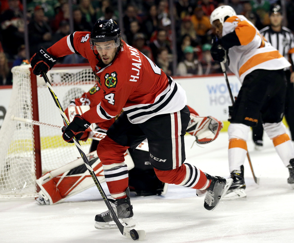 FILE - In this March 16, 2016, file photo, Chicago Blackhawks defenseman Niklas Hjalmarsson (4) controls the puck during the first peri...