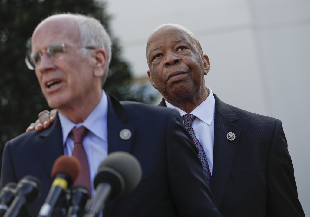 Rep. Elijah Cummings, D-Md. listens as right as  Rep. Peter Welch, D-Vt. speaks to members of the media outside the West Wing of the Wh...