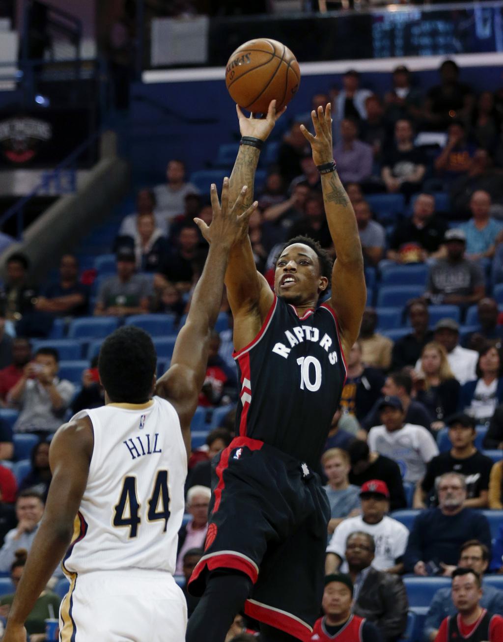 Toronto Raptors guard DeMar DeRozan (10) shoots over New Orleans Pelicans forward Solomon Hill (44) during the first half of an NBA bas...