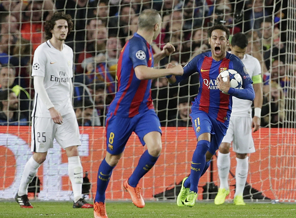 Barcelona's Neymar celebrates after PSG's Layvin Kurzawa scored an own goal during the Champions League round of 16, second leg soccer ...