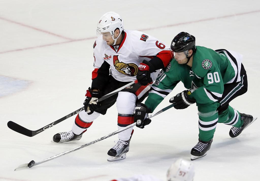 Dallas Stars center Jason Spezza (90) reaches in to take control of the puck from Ottawa Senators' Chris Wideman (6) in the third perio...