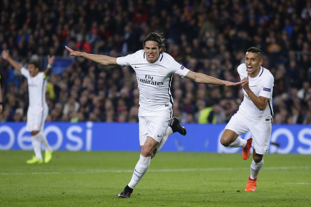 PSG's Edinson Cavani celebrates scoring his side's 1st goal during the Champions League round of 16, second leg soccer match between FC...