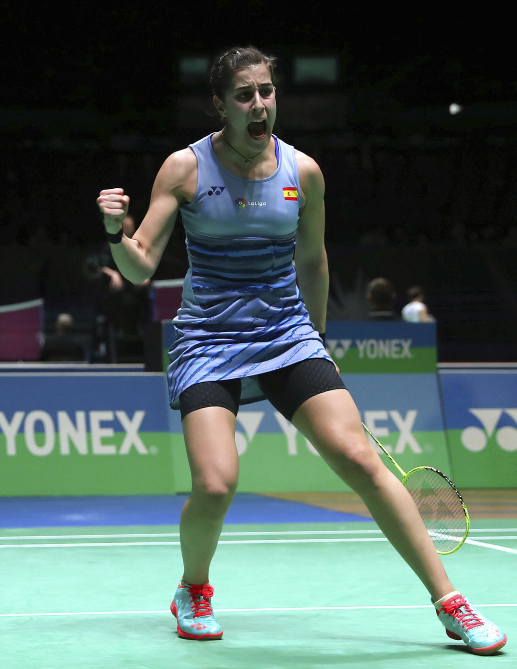 Spain's Carolina Marin celebrates winning her Women's singles match during day two of the All England Open Badminton Championships in B...