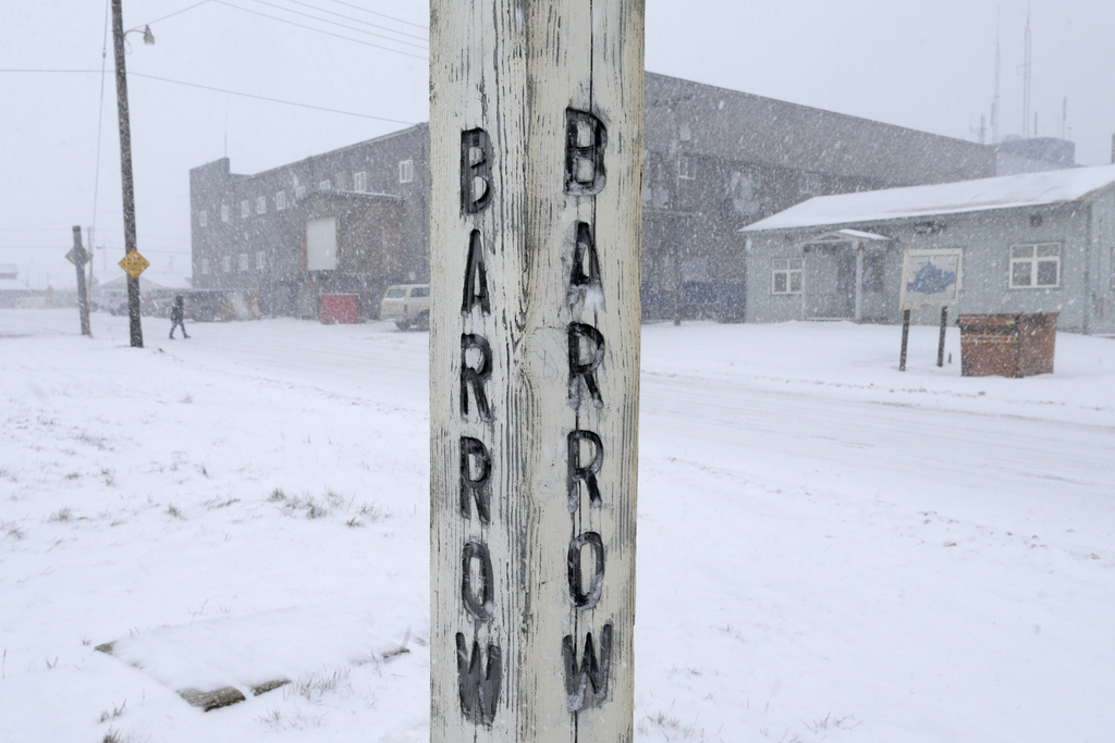 FILE - In this Oct. 10, 2014, file photo, snow falls around a sign in Barrow, Alaska. A court hearing is set for Thursday, March 9, 201...