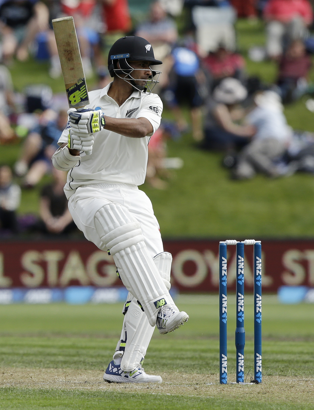 New Zealand's Jeet Raval watches as he p[lays a pulls hot while batting against South Africa during the first cricket test at Universit...