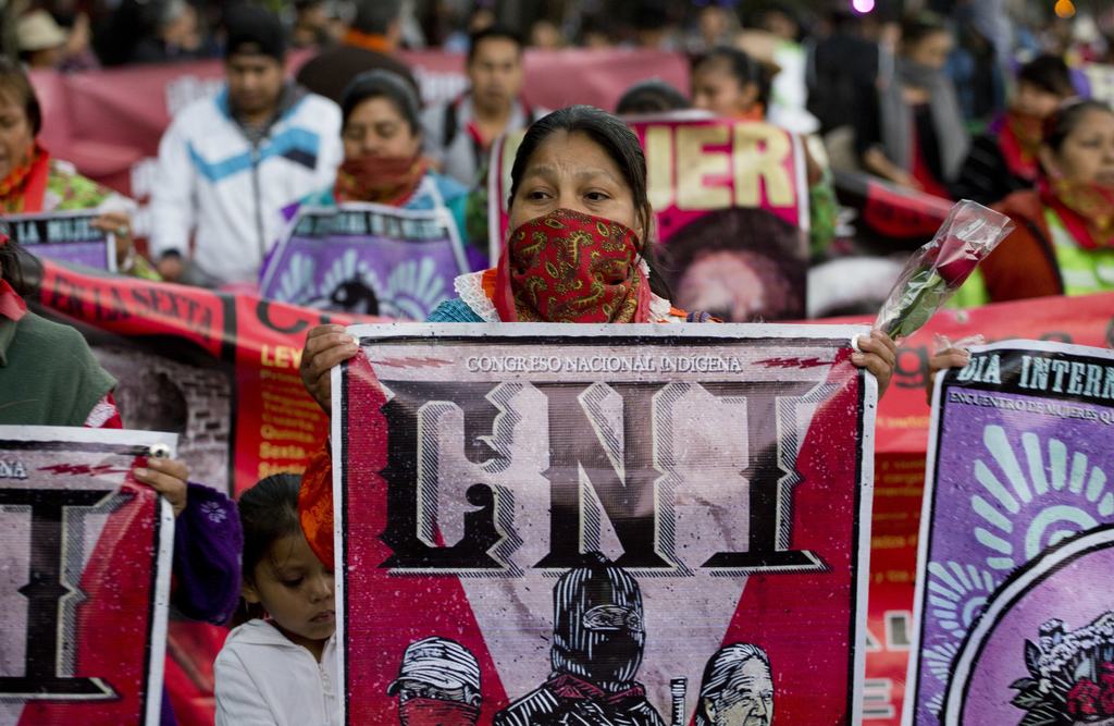 Women from the National Indigenous Congress march during a demonstration marking International Women's Day in Mexico City, Wednesday, M...