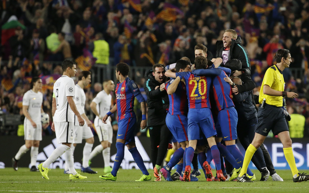 Barcelona players celebrate at the end of the Champions League round of 16, second leg soccer match between FC Barcelona and Paris Sain...