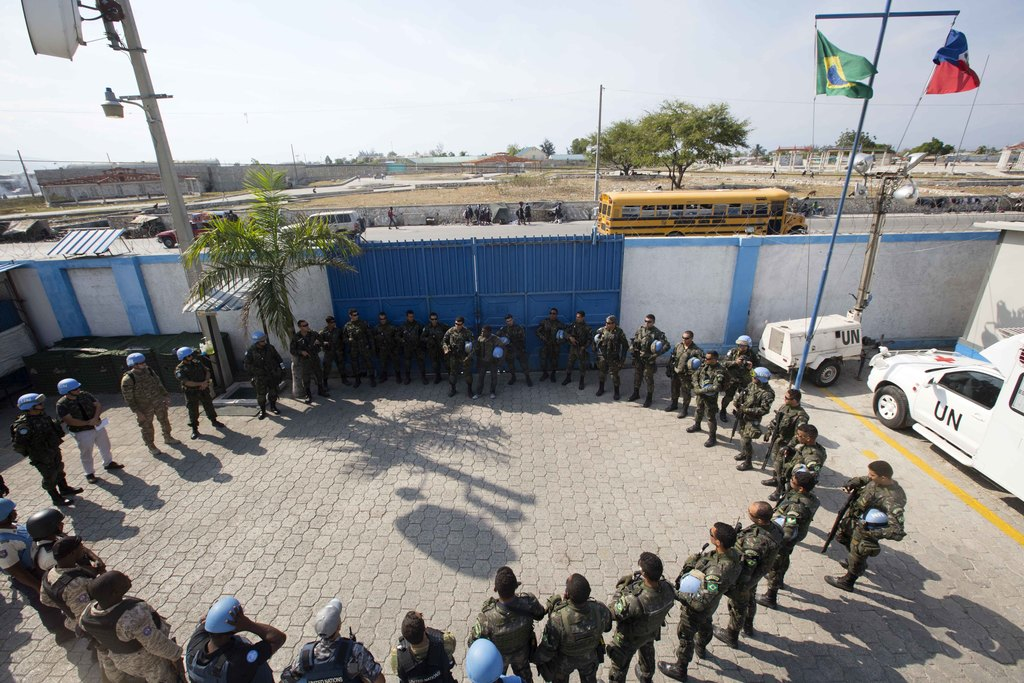 In this Feb. 22, 2017 photo, U.N. peacekeepers from Brazil meet before patrolling in the Cite Soleil slum, in Port-au-Prince, Haiti. Th...
