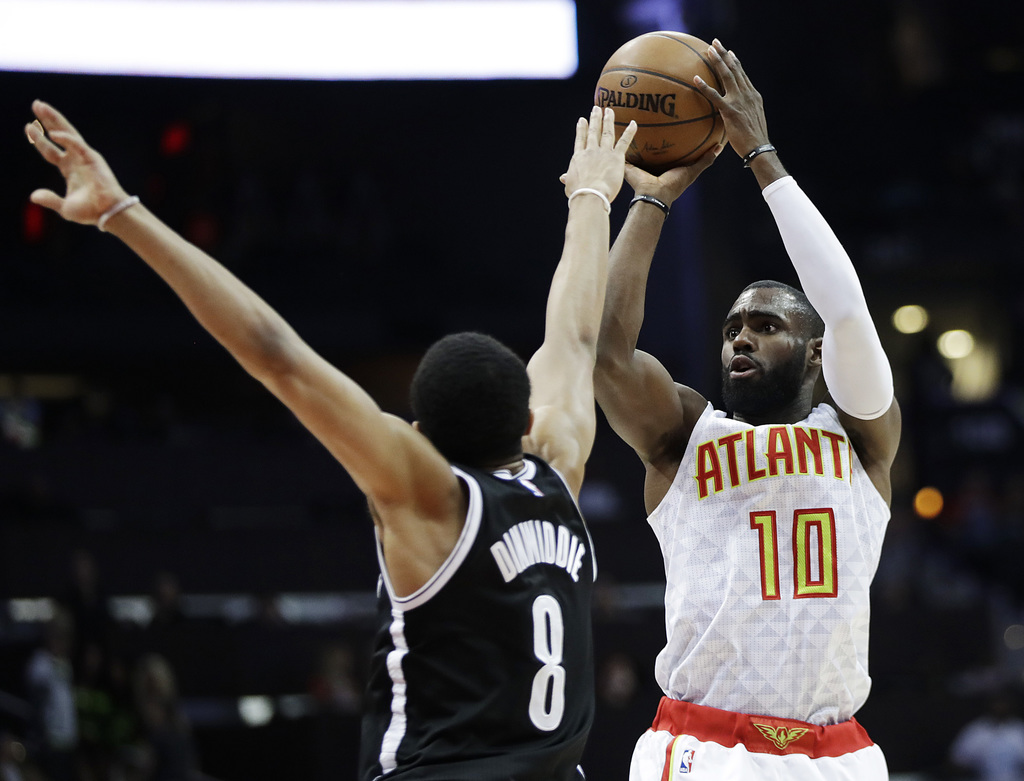Atlanta Hawks' Tim Hardaway Jr. shoots against Brooklyn Nets' Spencer Dinwiddie during the third quarter of an NBA basketball game in A...