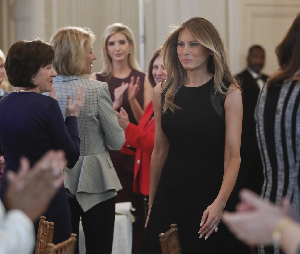 First lady Melania Trump walks into the State Dining room of the White House in Washington, Wednesday, March 8, 2017, where she hosted ...